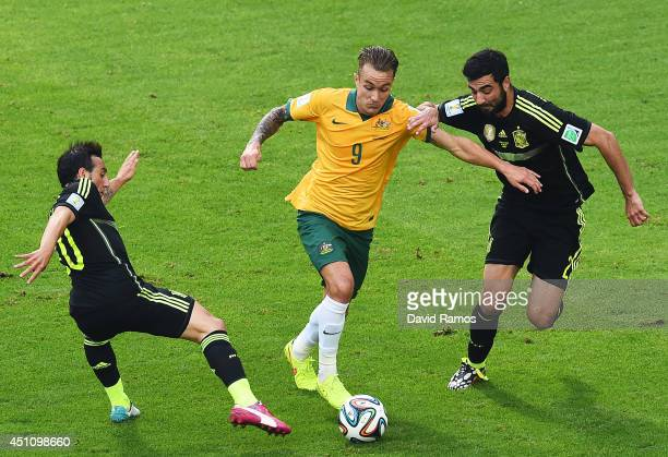 Adam Taggart of Australia is challenged by Santi Cazorla and Raul Albiol of Spain during the 2014 FIFA World Cup Brazil Group B match between...