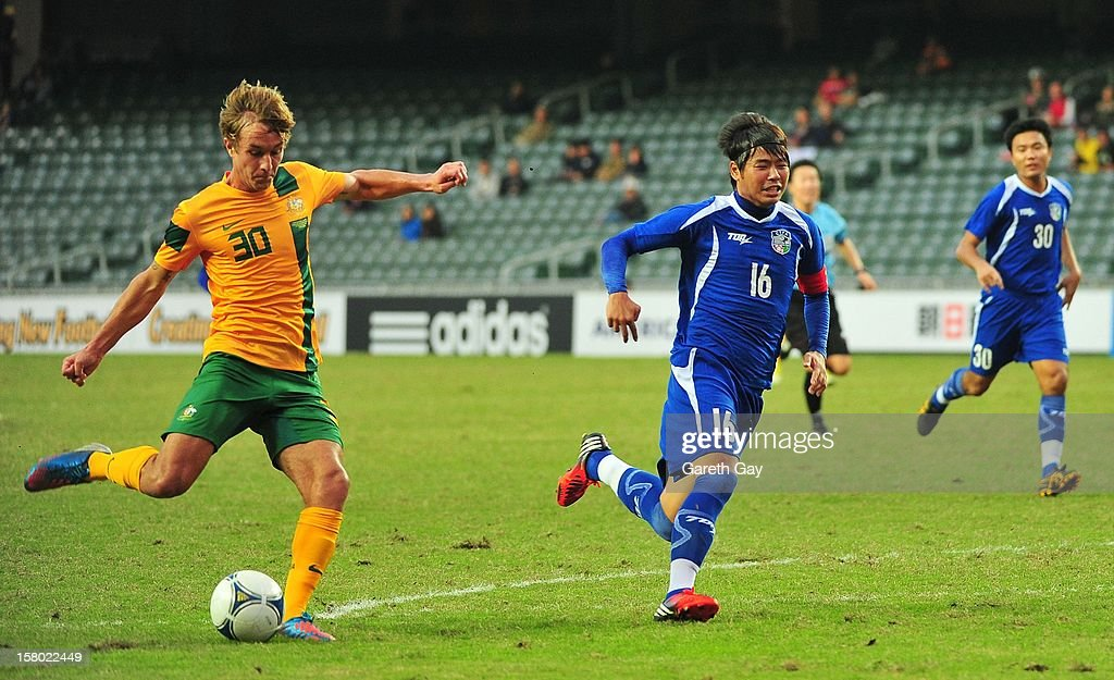 Adam Taggart (L) of Australia kicks the ball during the EAFF East Asian Cup 2013 Qualifying match between Chinese Tapei and the Australian Socceroos at Hong Kong Stadium on December 9, 2012 in So Kon Po, Hong Kong.