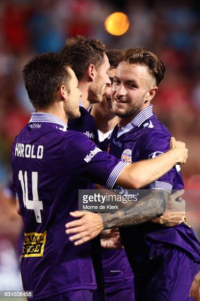 Adam Taggart of Perth Glory celebrates with teammates after he scored a goal during the round 19 ALeague match between Adelaide United and Perth...