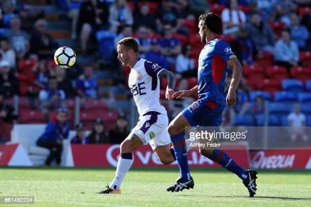 Adam Taggart of Perth Glory controls the ball ahead of the Jets defence during the round two ALeague match between the Newcastle Jets and Perth Glory...
