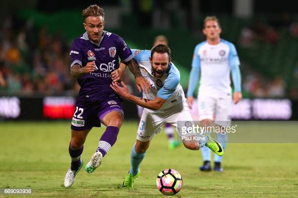 Adam Taggart of the Glory and Josh Rose of Melbourne contest for the ball during the round 27 ALeague match between the Perth Glory and Melbourne...