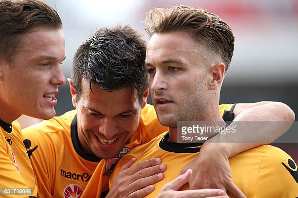 Adam Taggart of the Glory celebrates a goal with team mates during the round 15 ALeague match between the Newcastle Jets and the Perth Glory at...