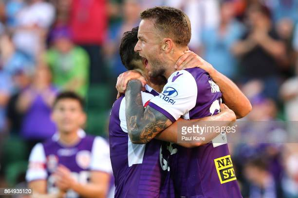 Adam Taggart of the Glory celebrates a goal with Xavier Torres during the round three ALeague match between Perth Glory and the Central Coast...
