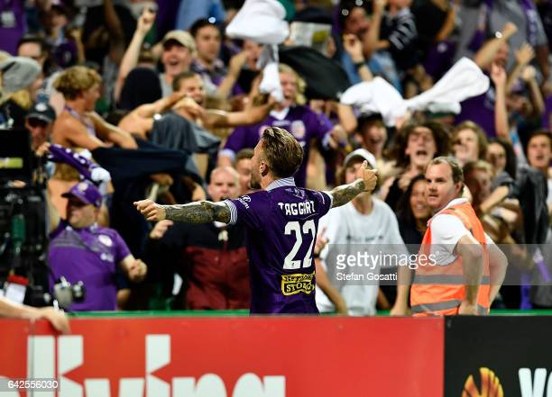 Adam Taggart of the Glory celebrates with fans after scoring a goal during the round 20 ALeague match between Perth Glory and Brisbane Roar at nib...