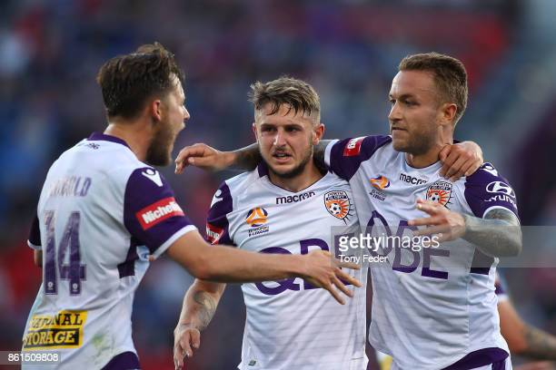 Adam Taggart of the Glory celebrates with teammates during the round two ALeague match between the Newcastle Jets and the Perth Glory at McDonald...