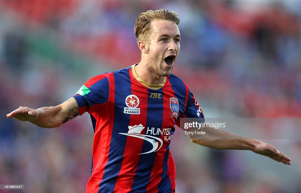 Adam Taggart of the Jets celebrates a goal during the round seven A-League match between the Newcastle Jets and the Melbourne Heart at Hunter Stadium on November 24, 2013 in Newcastle, Australia.
