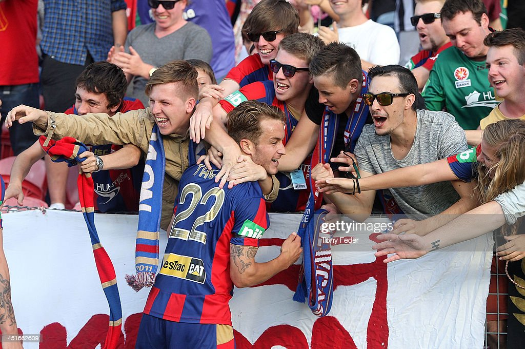 Adam Taggart of the Jets celebrates a goal with the crowd during the round seven A-League match between the Newcastle Jets and the Melbourne Heart at Hunter Stadium on November 24, 2013 in Newcastle, Australia.