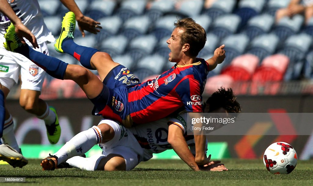 Adam Taggart of the Jets collides with Joshua Risdon of the Glory during the round two A-League match between the Newcastle Jets and the Perth Glory at Hunter Stadium on October 20, 2013 in Newcastle, Australia.