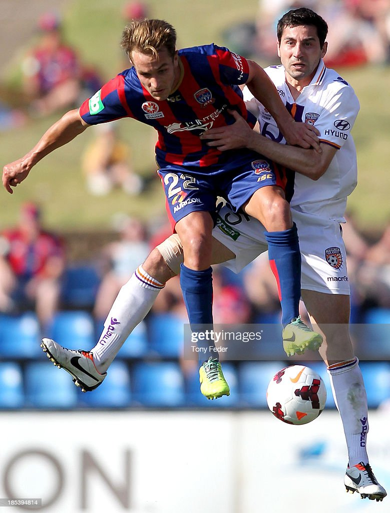 Adam Taggart of the Jets contests the ball against Steve Pantelidis of the Glory during the round two A-League match between the Newcastle Jets and the Perth Glory at Hunter Stadium on October 20, 2013 in Newcastle, Australia.