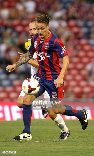 Adam Taggart of the Jets controls the ball ahead of Andrew Durante of the Phoenix during the round 24 ALeague match between the Newcastle Jets and...