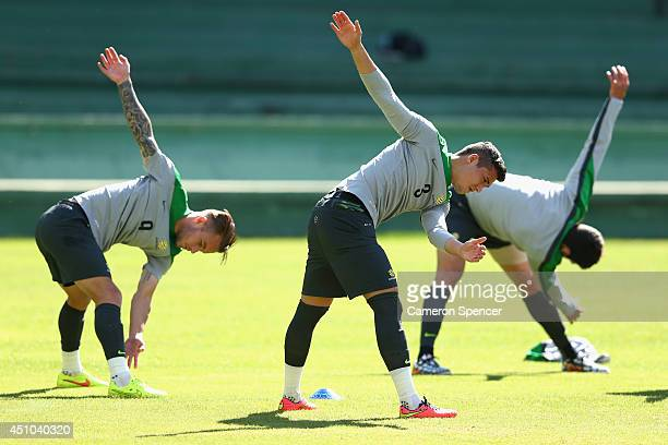 Adam Taggart of the Socceroos and Jason Davidson of the Socceroos stretch during an Australian Socceroos training session and press conference at...