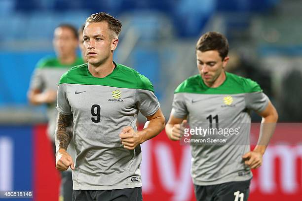 Adam Taggart of the Socceroos and Tommy Oar of the Socceroos warm up during an Australian Socceroos training session at Arena Pantanal on June 12...