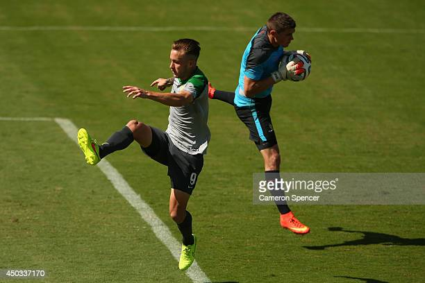 Adam Taggart of the Socceroos attempts to kick the ball as Mat Ryan of the Socceroos gathers it during an Australian Socceroos training session at...