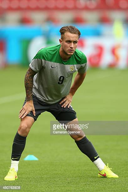 Adam Taggart of the Socceroos stretches during an Australian Socceroos training session and press conference at Estadio BeiraRio on June 17 2014 in...