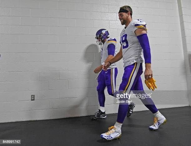 Adam Thielen of the Minnesota Vikings and Case Keenum head towards the field before the start of the game against the Pittsburgh Steelers at Heinz...