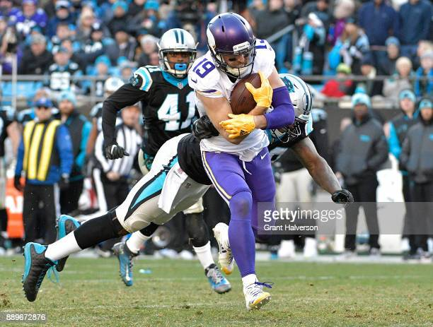 Adam Thielen of the Minnesota Vikings breaks away from Thomas Davis of the Carolina Panthers for a touchdown duering the fourth quarter of their game...