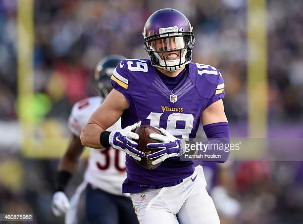 Adam Thielen of the Minnesota Vikings carries the ball against the Chicago Bears during the third quarter of the game on December 28 2014 at TCF Bank...