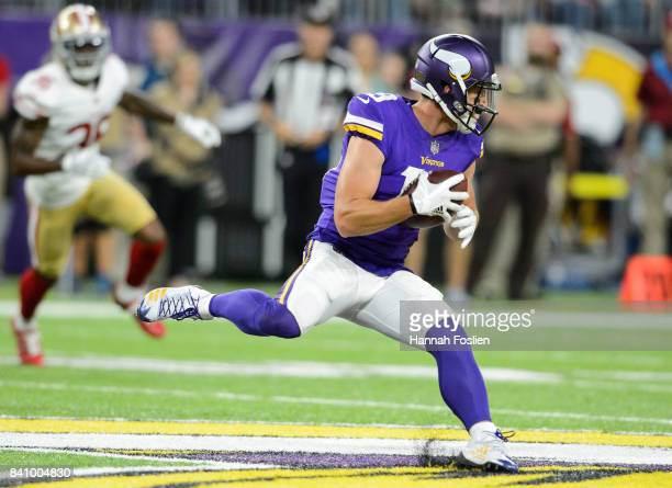 Adam Thielen of the Minnesota Vikings carries the ball against the San Francisco 49ers in the preseason game on August 27 2017 at US Bank Stadium in...