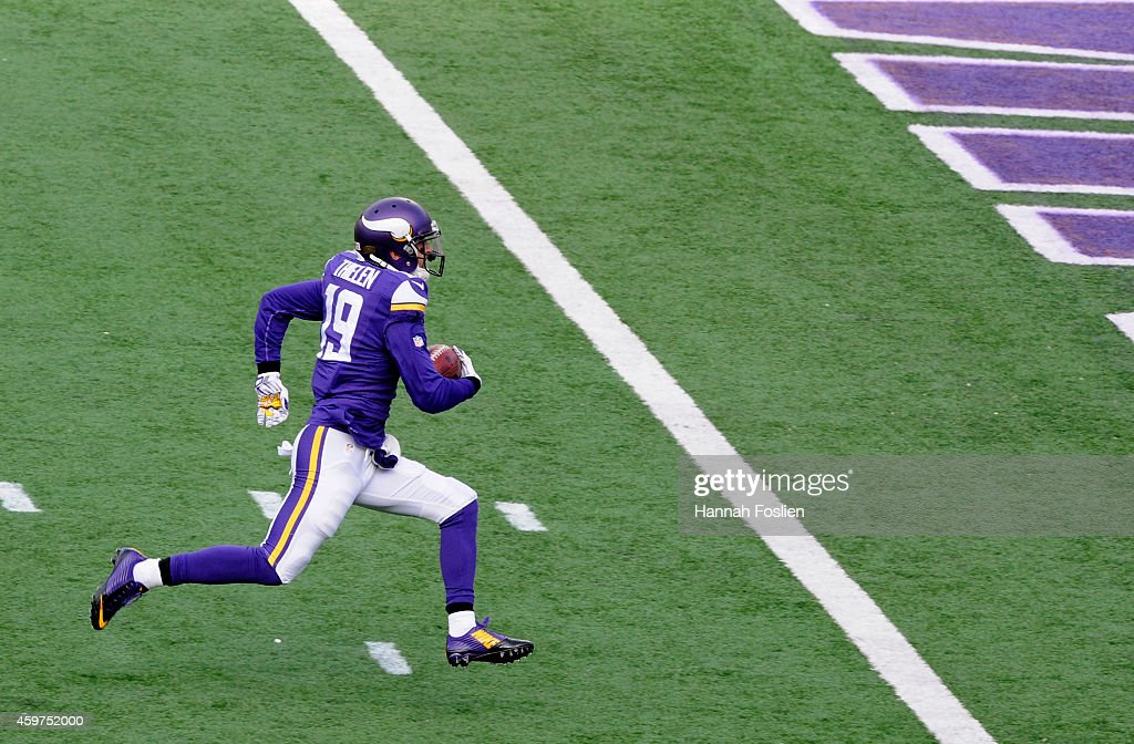 Adam Thielen of the Minnesota Vikings carries the ball to the end zone against the Carolina Panthers during the first quarter of the game on November...