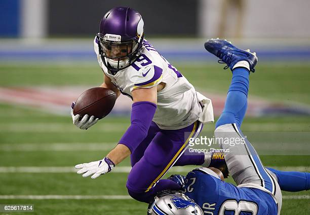 Adam Thielen of the Minnesota Vikings is tackled by Tavon Wilson of the Detroit Lions during second half action at Ford Field on November 24 2016 in...