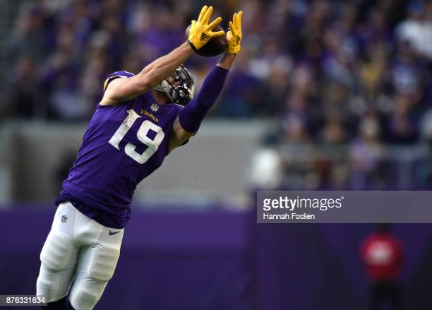 Adam Thielen of the Minnesota Vikings leaps to catch the ball in the third quarter of the game against the Los Angeles Rams on November 19 2017 at US...