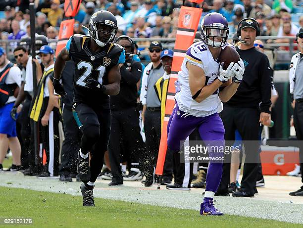 Adam Thielen of the Minnesota Vikings makes a catch along the sideline as Prince Amukamara of the Jacksonville Jaguars trails during the game at...