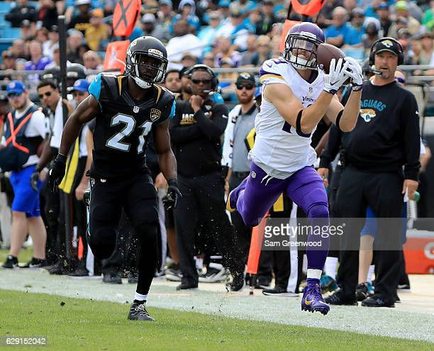 Adam Thielen of the Minnesota Vikings makes a catch in front of Prince Amukamara of the Jacksonville Jaguars during the game at EverBank Field on...