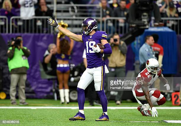 Adam Thielen of the Minnesota Vikings signals for a first down after catching the ball in the first quarter of the game against the Arizona Cardinals...