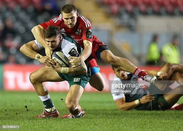 Adam Thompstone of Leicester is tackled by Andrew Conway during the European Rugby Champions Cup match between Leicester Tigers and Munster at...