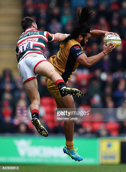 Adam Thompstone of Leicester Tigers and Thretton Palamo of Bristol challenge for the ball during the Aviva Premiership match between Leicester Tigers...
