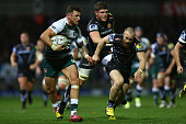 Adam Thompstone of Leicester Tigers bursts past James Short of Exeter Chiefs during the Aviva Premiership match between Exeter Chiefs and Leicester...