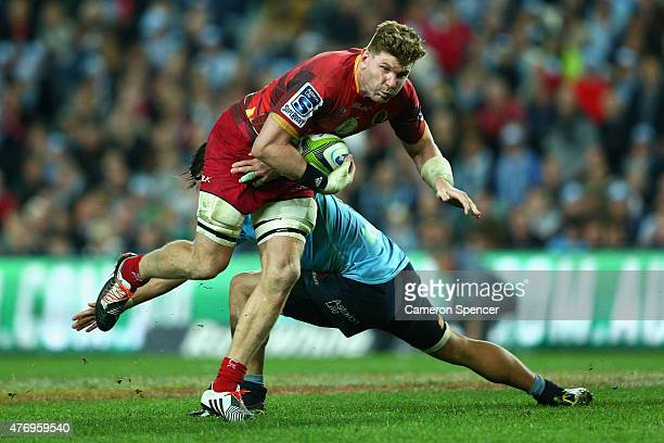 Adam Thomson of the Reds is tackled during the round 18 Super Rugby match between the Waratahs and the Reds at Allianz Stadium on June 13 2015 in...