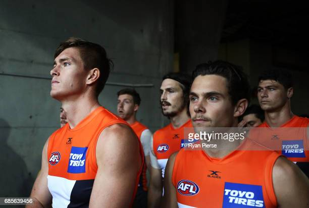 Adam Tomlinson and Josh Kelly of the Giants lead their team out during the round nine AFL match between the Greater Western Sydney Giants and the...