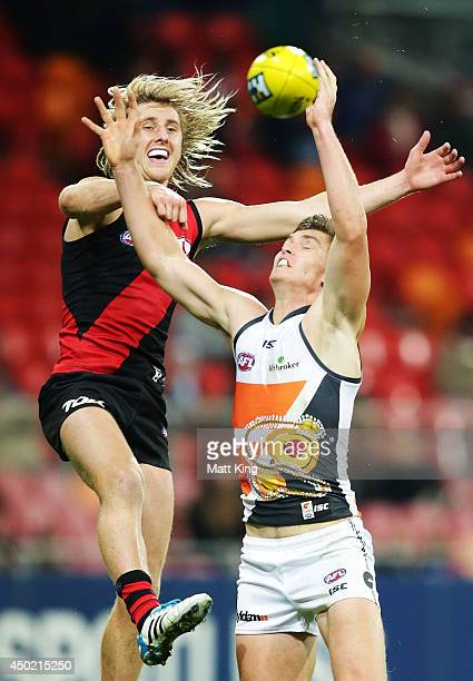 Adam Tomlinson of the Giants competes for the ball against Dyson Heppell of the Bombers during the round 12 AFL match between the Greater Western...