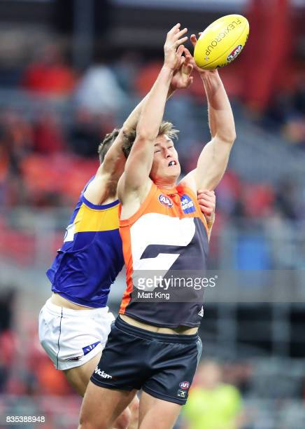 Adam Tomlinson of the Giants is challenged by Jack Redden of the Eagles during the round 22 AFL match between the Greater Western Sydney Giants and...