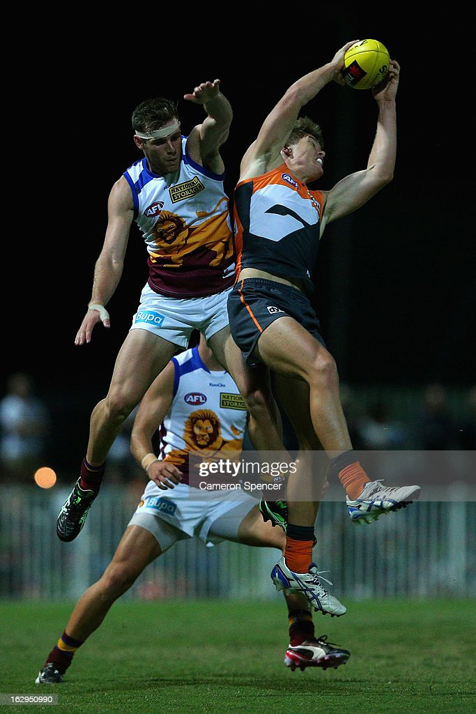 Adam Tomlinson of the Giants takes a mark during the round two AFL NAB Cup match between the Greater Western Sydney Giants and the Brisbane Lions at the Robertson Oval in Wagga Wagga, Australia.