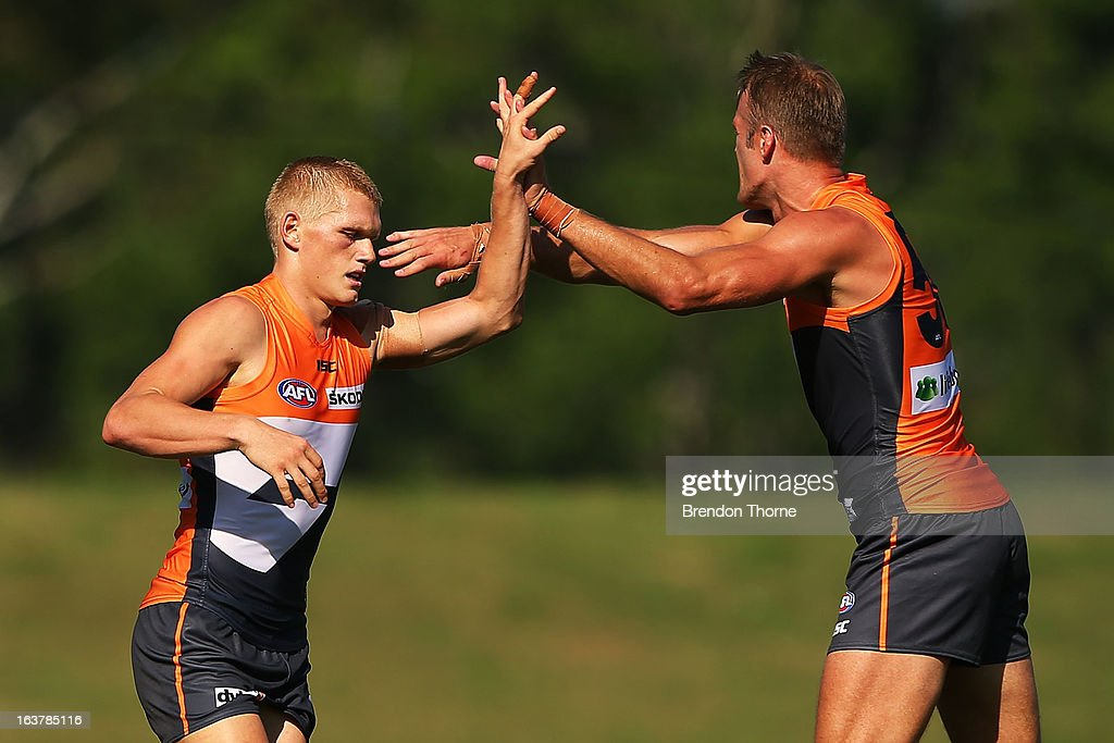 Adam Treloar of the Giants celebrates with team mate Dean Brogan after kicking a goal during the AFL practice match between the Greater Western...