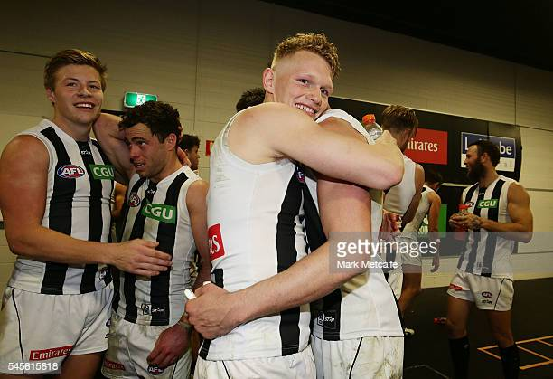 Adam Treloar of the Magpies embraces team mate Scott Pendlebury after victory in the round 16 AFL match between the Greater Western Sydney Giants and...