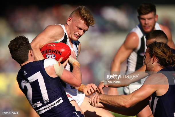 Adam Treloar of the Magpies gets tackled by Lachie Neale of the Dockers during the round 11 AFL match between the Fremantle Dockers and the...