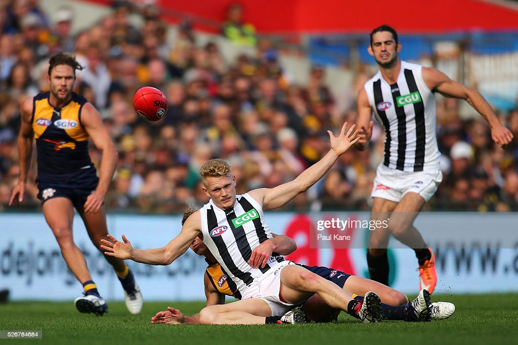 Adam Treloar of the Magpies gets tackled by Matt Priddis of the Eagles during the round six AFL match between the West Coast Eagles and the Collingwood Magpies at Domain Stadium on May 1, 2016 in Perth, Australia.