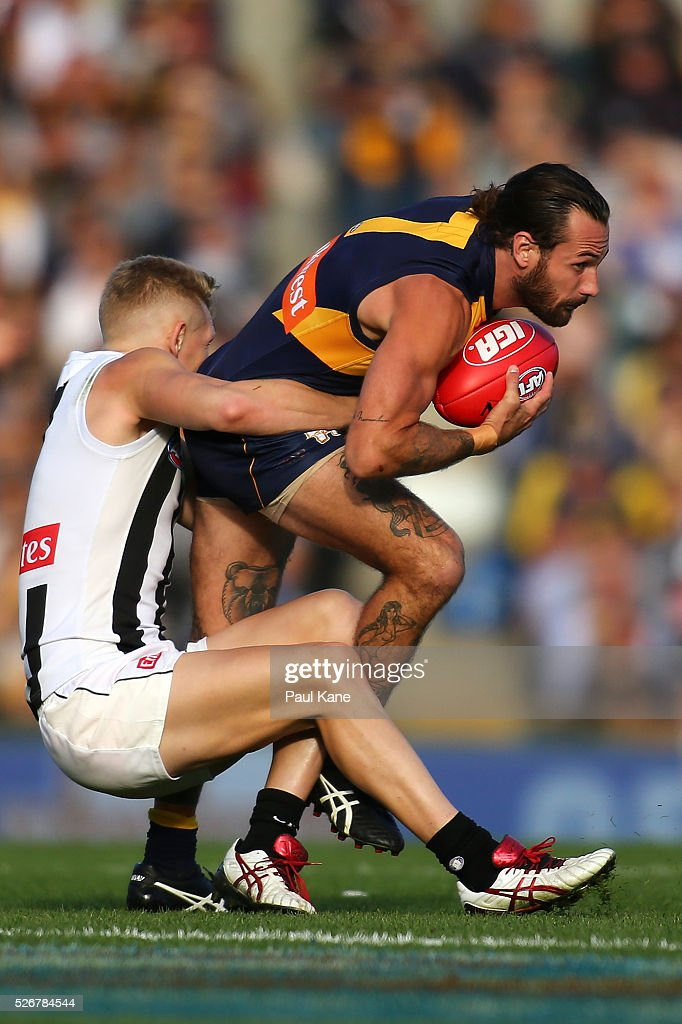 Adam Treloar of the Magpies tackles Chris Masten of the Eagles during the round six AFL match between the West Coast Eagles and the Collingwood Magpies at Domain Stadium on May 1, 2016 in Perth, Australia.