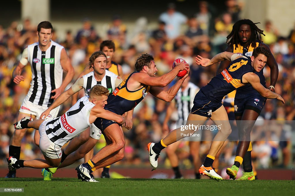 Adam Treloar of the Magpies tackles Mark Hutchings of the Eagles during the round six AFL match between the West Coast Eagles and the Collingwood Magpies at Domain Stadium on May 1, 2016 in Perth, Australia.