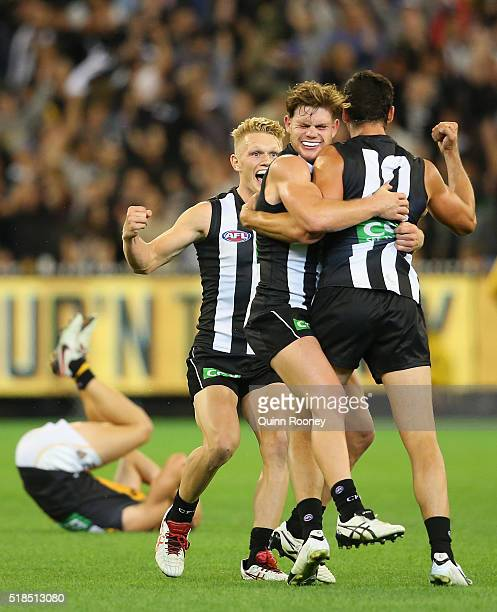 Adam Treloar Taylor Adams and Scott Pendlebury of the Magpies celebrate winning the round two AFL match between the Collingwood Magpies and the...