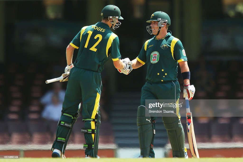 Adam Voges and Aaron Finch Australia 'A' shake hands after reaching their one hundred run partnership during the International Tour match between Australia 'A' and the England Lions at Sydney Cricket Ground on February 25, 2013 in Sydney, Australia.