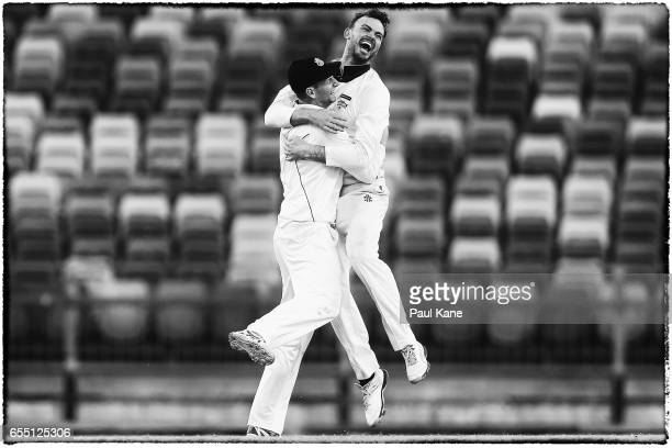 Adam Voges and Ashton Turner of Western Australia celebrate winning the Sheffield Shield match between Western Australia and New South Wales at WACA...