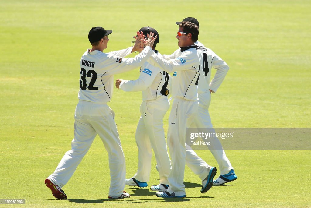 <a gi-track='captionPersonalityLinkClicked' href=/galleries/search?phrase=Adam+Voges&family=editorial&specificpeople=724770 ng-click='$event.stopPropagation()'>Adam Voges</a> and <a gi-track='captionPersonalityLinkClicked' href=/galleries/search?phrase=Marcus+North&family=editorial&specificpeople=167183 ng-click='$event.stopPropagation()'>Marcus North</a> of the Warriors celebrate the dismissal of Ed Cowan of the Tigers during day three of the Sheffield Shield match between the Western Australia Warriors and the Tasmania Tigers at the WACA on February 14, 2014 in Perth, Australia.