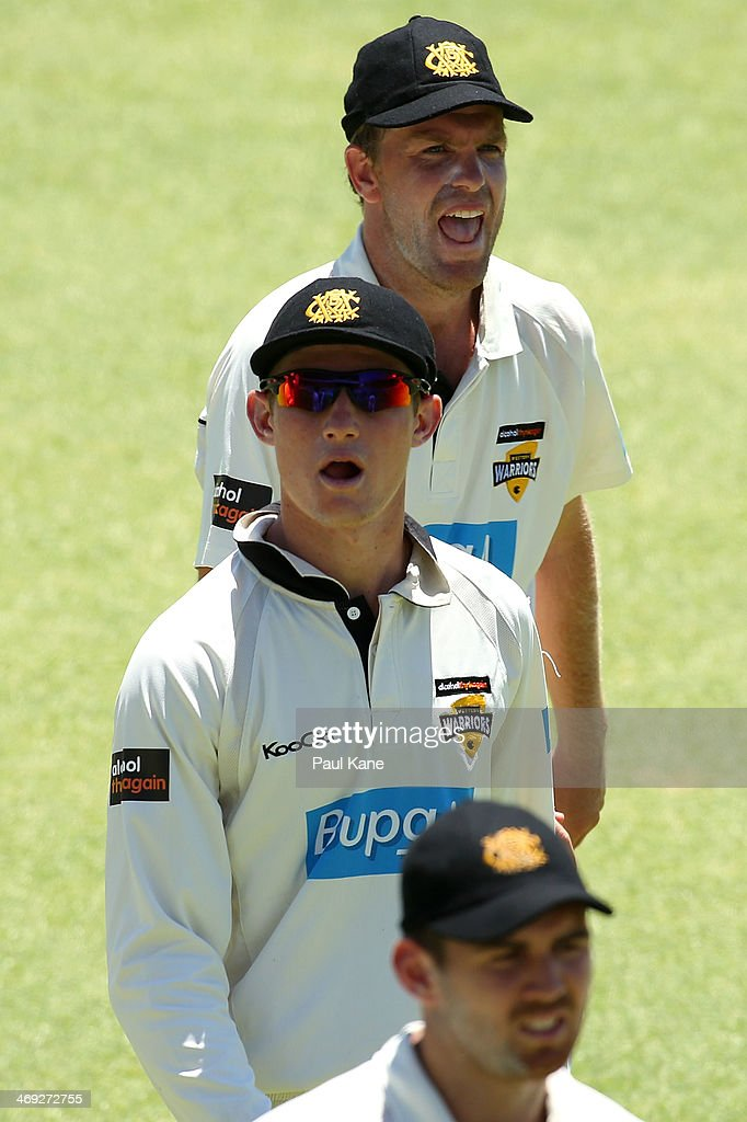 Adam Voges and Michael Beer of the Warriors look on while walking from the field at lunch during day three of the Sheffield Shield match between the Western Australia Warriors and the Tasmania Tigers at the WACA on February 14, 2014 in Perth, Australia.