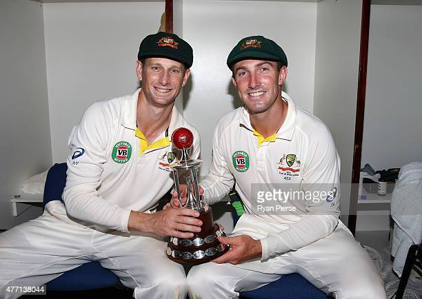 Adam Voges and Shaun Marsh of Australia pose with the Frank Worrell Trophy in the change rooms after day four of the Second Test match between...