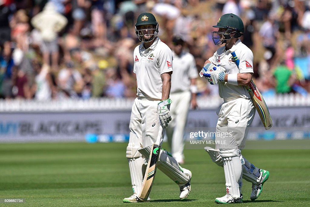 Adam Voges (L) of Australia and teammate Peter Nevill (R) walk from the field at tea during day two of the first cricket Test match between New Zealand and Australia at the Basin Reserve in Wellington on February 13, 2016. AFP PHOTO / MARTY MELVILLE / AFP / Marty Melville
