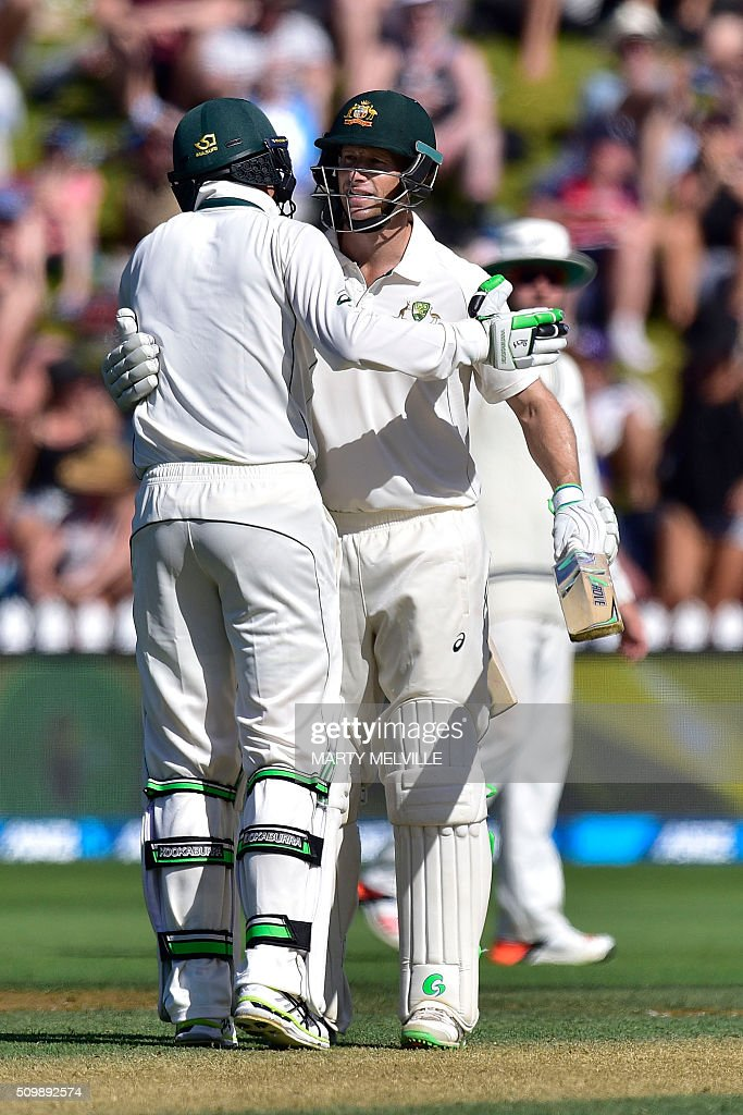 Adam Voges (R) of Australia celebrates 150 runs with team mate Peter Siddle (L) during day two of the first cricket Test match between New Zealand and Australia at the Basin Reserve in Wellington on February 13, 2016. AFP PHOTO / MARTY MELVILLE / AFP / Marty Melville